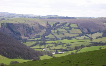 Coming down from Offas Dyke. The Lodges can be seen at the bottom centre of picture
