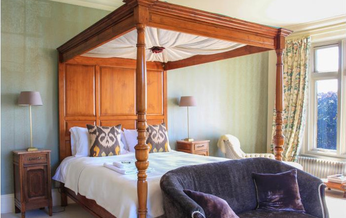 One of the 12 bedrooms at Amberstone Manor - this one has a four poster bed