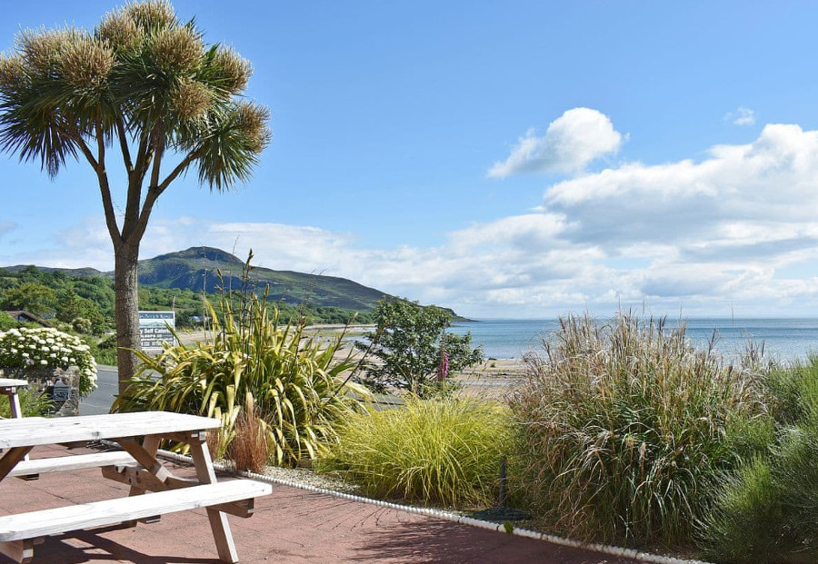 Big Beach House has views over Whiting Bay from the garden