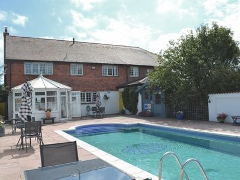 Cockle Warren On Hayling Island In Hampshire Is A Holiday Cottage With A Swimming Pool Which