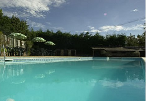 Take a dip in the swimming pool at Collacott Farm Cottages