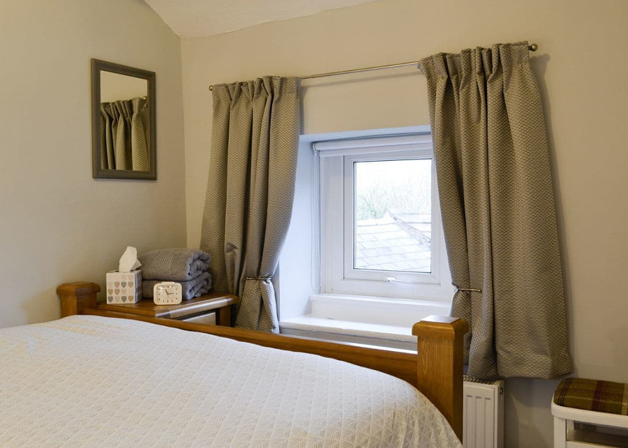 Marron Cottage in Cumbria has a double bedroom and a twin bedroom. This is the double bedroom