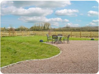 Enjoy a cup of tea in the garden at Pillar Box Barn