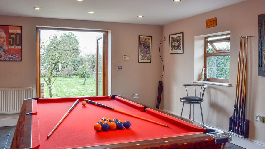 A seperate room in the garden houses the pool table