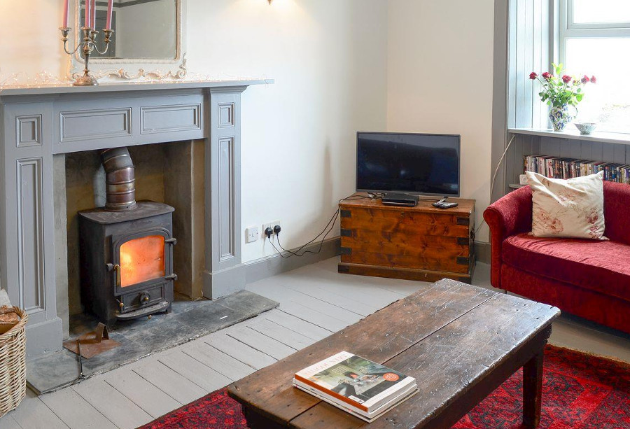 The wood burning stove in the living room at Seafield House