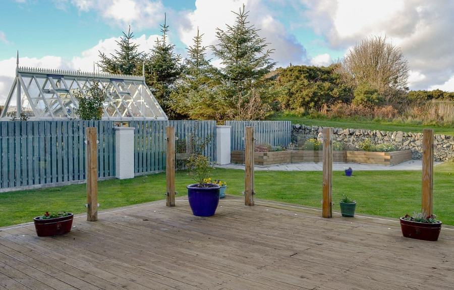 Seaward has a decked area, and a large lawned garden