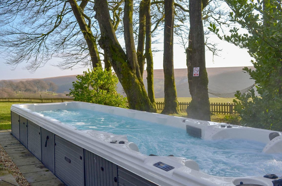 The fantastically large hot tub in the garden at The Grange at Grange Estate, Somerset