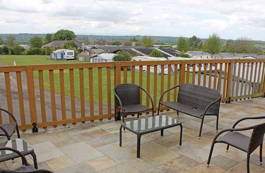 On the veranda at one of the lodges, Bucklegrove Holiday Park