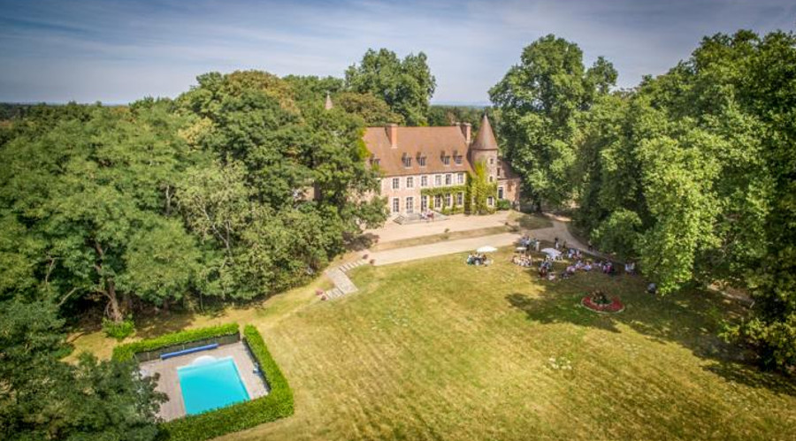 The garden and swimming pool at Chateau Du Marquis De Tracy in Paray le Fresil