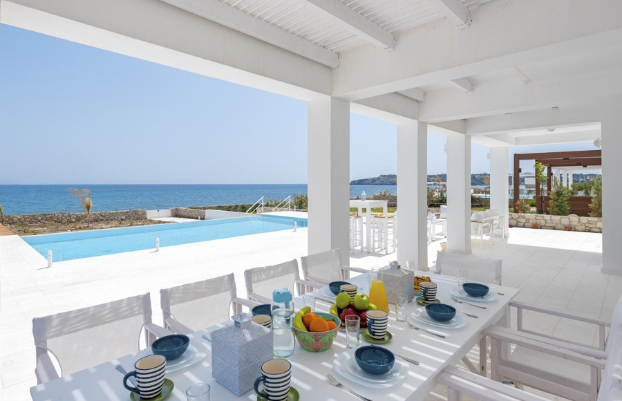 Villa Constantine on Rhodes has a shaded dining area next to the infinity pool