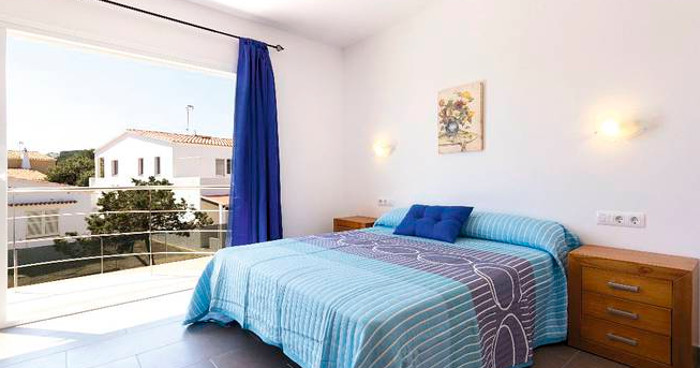 One of the four bedrooms at Villa Garbo in Arenal d'en Castell, Menorca